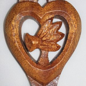 Blossoming Heart lovespoon, daffodil close up handcarved at The Lovespoon Workshop.