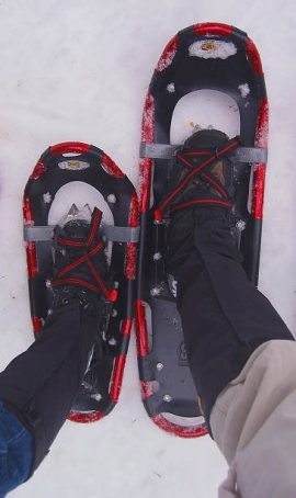 hiking boots and snowshoes