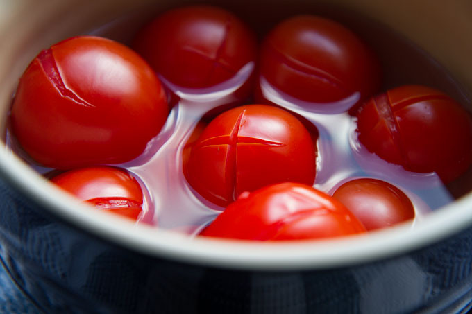 Tomatoes blanching in hot water