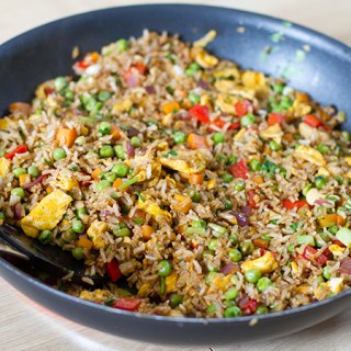 Egg fried rice with cashew nuts, ginger and lime