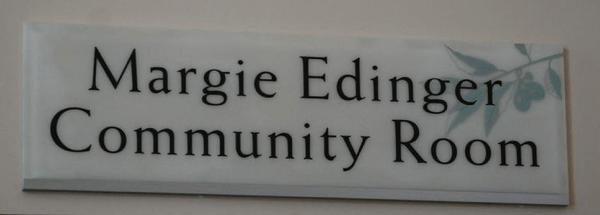 Sign hanging above the Margie Edinger Community Room