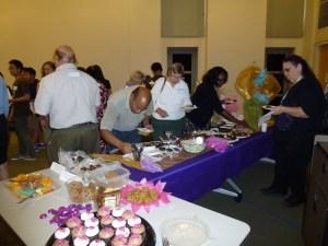 Volunteers enjoying the goodies.