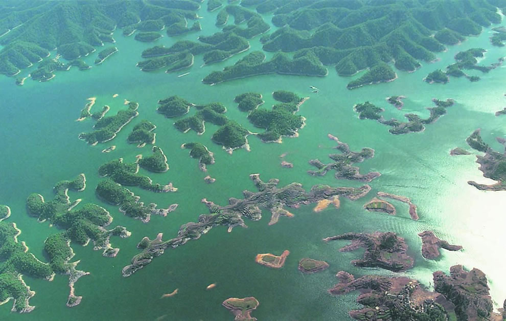 Aerial shot of Thousand Island Lake in China, underneath is the Lost Lion City