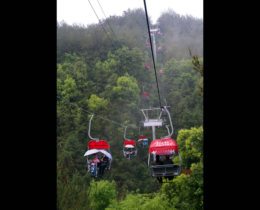 Cable cars over lush forests, another mode of transportation on Qiandaohu
