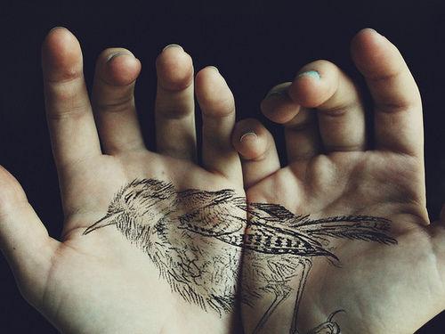 bird hand tattoo
