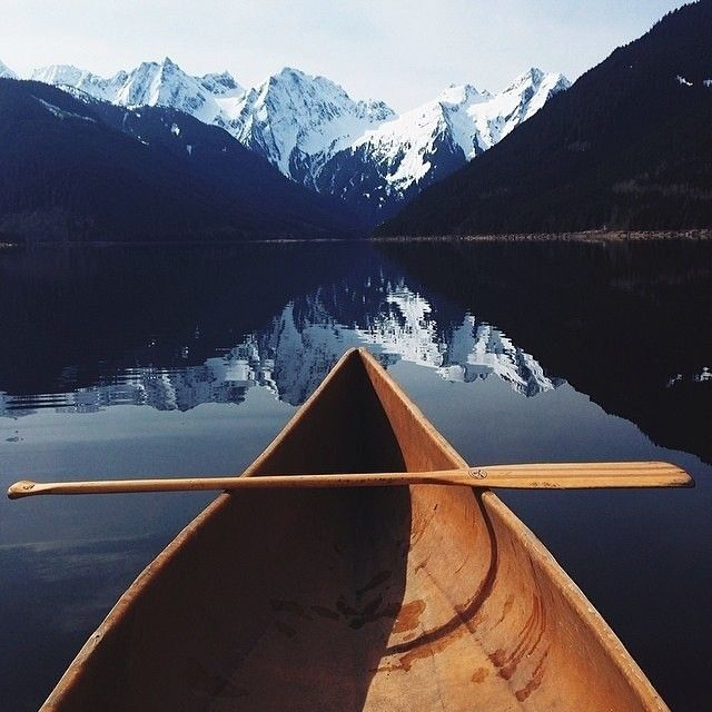 Canoe Below The Mountains Pictures Photos And Images For