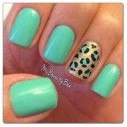 teal and gold leopard nails
