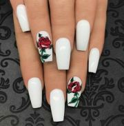 white nails with rose design