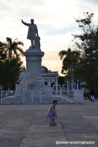 Love travelling family in Parque Jose Martí, Cienfuegos, Cuba