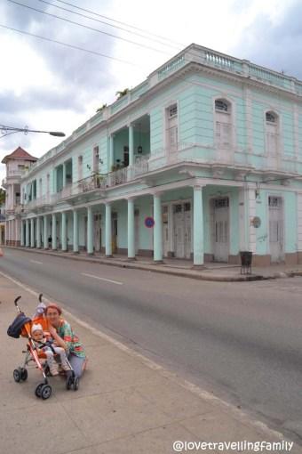 Love travelling family in Paseo del Prado, Cienfuegos, Cuba