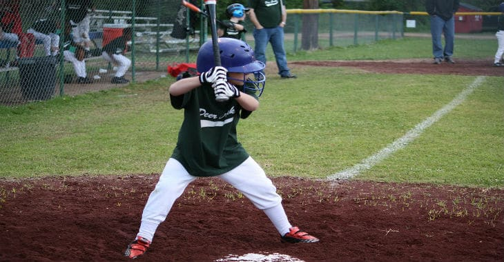 Little league baseball player batting. This is one of the many recreational opportunities for K-2, IR-2 and CR-2 children and teenagers of immigrants