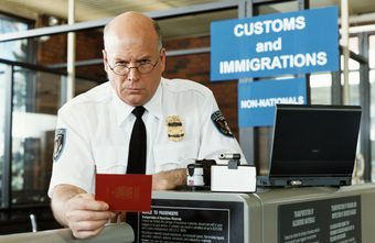 US immigrations officer inspecting foreign passport with new eVisa.