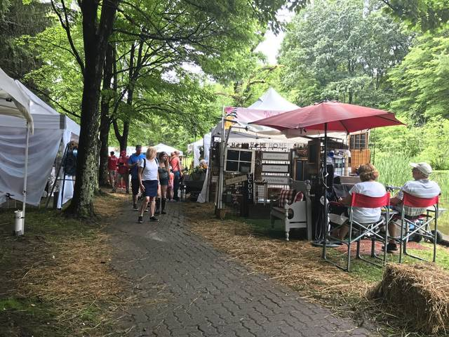 People attend the final day of the Westmoreland Arts and Heritage Festival on Sunday despite threats of rain.