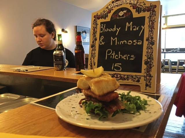 Employee Lindsay Bonnett checks on a lunch order at Major Stokes restaurant in Greensburg.