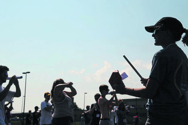 Drum Major Madison Shaffer keeps time and calls movements during the first day of band practice at Hempfield Area High School in Hempfield Township.