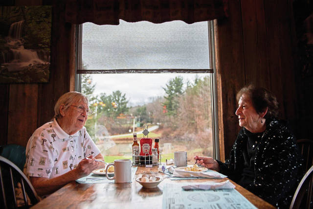 Wilma Mowry, 80, (right) and Garnet Overly, 94, chat with one another while having pie at Brady's Restaurant in Acme.