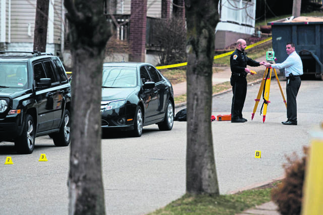 Police investigate at the scene of a fatal shooting in Greensburg on March 13, 2019. A Greensburg police officer fatally shot Nina Adams after, police say, she pointed a loaded gun at officers and ignored commands to put the gun down.