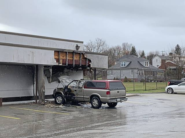 A vehicle fire caused minor damage to the Mt. Pleasant Post Office on Friday.
