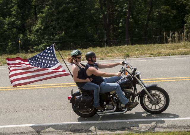 Bikers ride along Donohoe Road while participating in Patriot Thunder, a free motorcycle ride, that started in Latrobe on Saturday<ins>, July 4, 2020</ins>.
