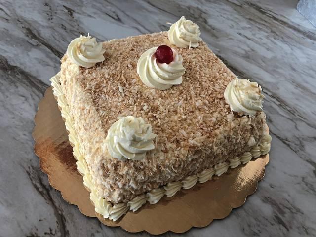 Prantl's latest — the burnt almond torte—pina colada cake