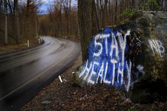 A rock along Kecksburg Road in Mt. Pleasant Township has been defaced with encouraging signs of support in the wake of the coronavirus pandemic.