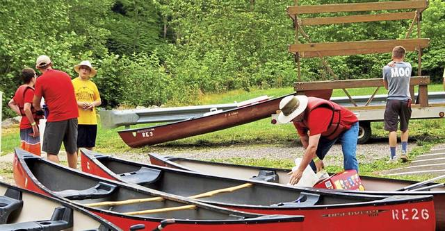 Boy Scout Troop 834 of Scott Township prepare to launch their kayak and canoe rentals at Roaring Run in Kiski Township for a June 2019 float trip on the Kiski River.