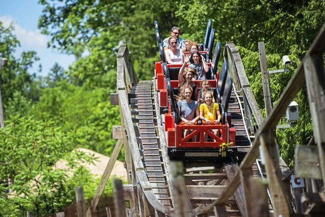 Guests ride the 1938 wooden coaster Rollo Coaster, at Idlewild and SoakZone in Ligonier Township, on Thursday, June 27, 2019.