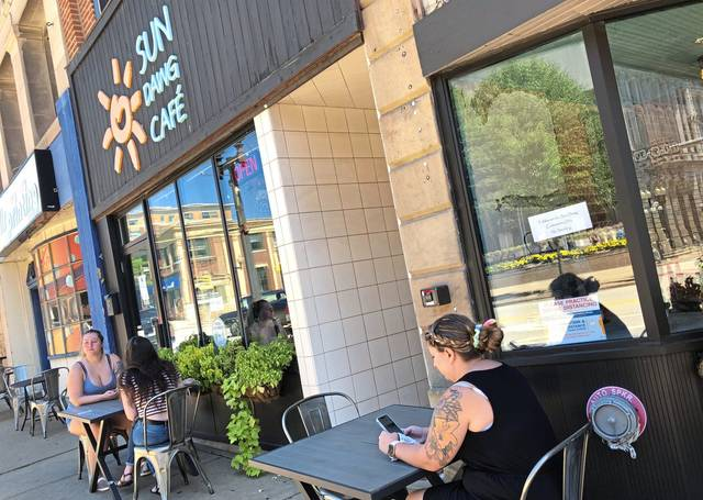 Sun Dawg Cafe is among eateries participating in Greensburg Restaurant Week, Aug. 24-30. From left: Juliana Sorace and Kayla Griest, both of Greensburg, and Breanna Little of Derry enjoy an al fresco lunch on Aug. 19.