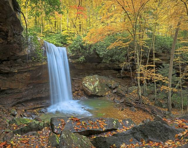 Fall foliage views, like this one of Cucumber Falls in Ohiopyle State Park, draw many tourists to the Laurel Highlands.
