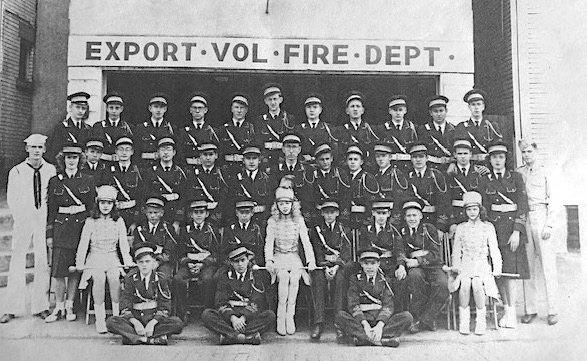 Above, an undated group photo of Export Volunteer Fire Department personnel. The Export Historial Society is funding a new sign modeled on the fire house's original signage, one of many small-scale projects that have helped revitalize the town alongside larger ones like its flood control project and the completion of the Heritage Trail through the heart of its downtown area.