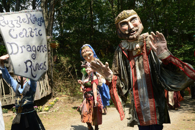 A life-size puppet of the king appears in a royal parade during the 2015 Pittsburgh Renaissance Festival.