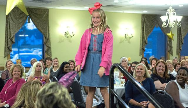 The annual YWCA Westmoreland County fashion show is going virtual this year. Here, Avery Heinnickel models an outfit from the YWCA's Greensburg thrift store during the 2018 event.