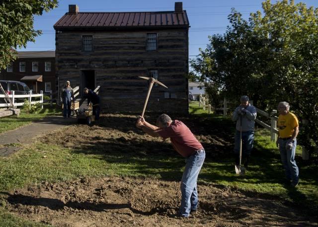 Volunteers help dig a rain and herb garden behind the Shields Farm log cabin house on Saturday<ins>,</ins><ins> Sept. 19, </ins><ins>2020</ins>.