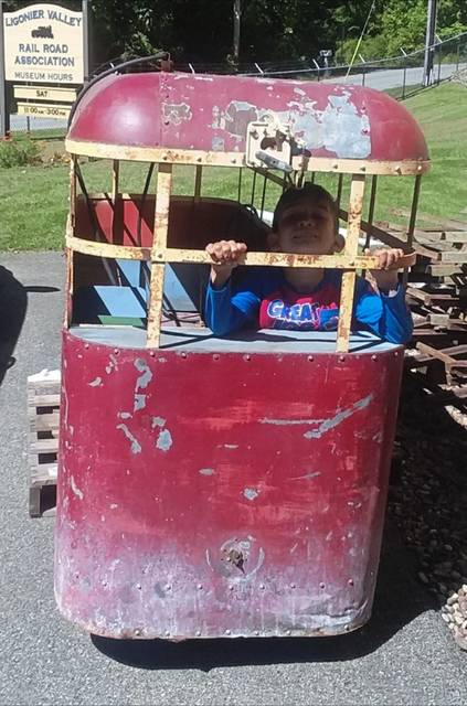 Johnny Klippa of Plum goes inside the old Doodleburg amusement car at the Ligonier Valley Rail Road Association museum in Ligonier Township.