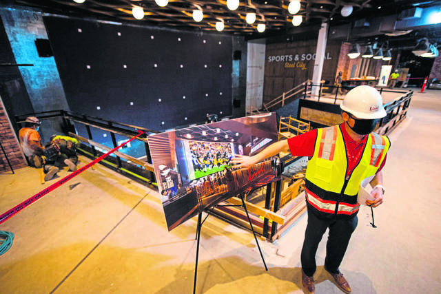 Brian Uran, vice president of marketing for Live! Casino Pittsburgh, explains to media the design for the Sports & Social Steel City restaurant and bar.