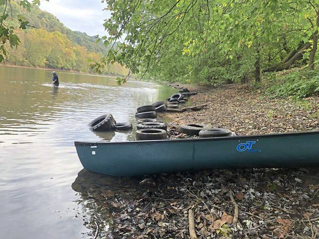 Volunteers clean up tires that had been dumped in the Youghiogheny River between Cedar Creek Park in Rostraver and West Newton last year.