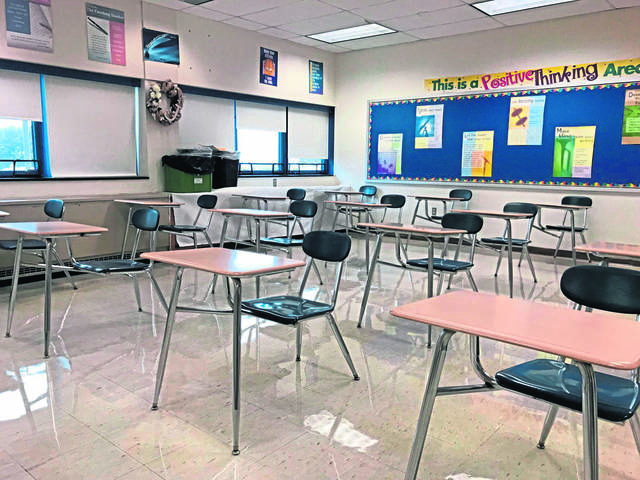 Desks are placed 6 feet apart in a classroom at Hempfield Area High School. The school is closed all week because of coronavirus.
