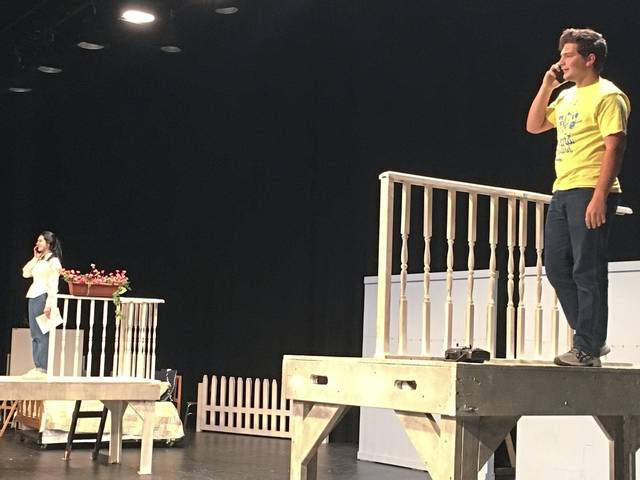 """Dom Panichelle, right, and fellow senior Sofia Herr portray neighbors who connect via phone while physically separated by a pandemic lockdown during arehearsal of the scene """"Rooftop Romance"""" in """"Love … No Barriers,"""" the Greater Latrobe Senior High fall play that will be streamed online Nov. 20-22."""