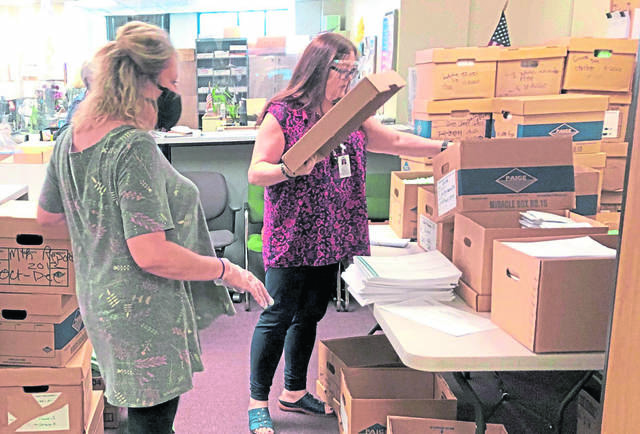 Workers at the Westmoreland County Elections Bureau in Greensburg sort through materials returned from voting precincts on Wednesday, Nov. 4, 2020.