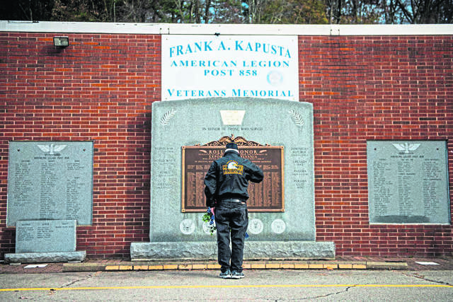 Veteran Bill Snodgrass, of Monroeville, a member of the Murrysville American Legion Post 711, salutes the memorial at the Export American Legion on Saturday, Nov. 9, 2019 during a honor roll ceremony ahead of Veterans' Day on Monday.