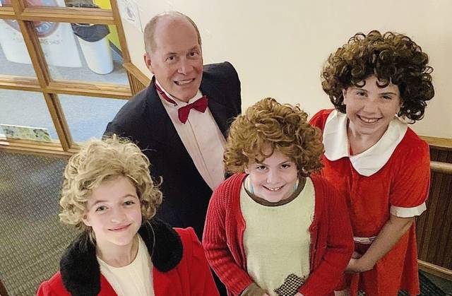"""Samantha Seech (from left), Felice Hutchinson and Magee Heverly will share the title role in Stage Right's """"Annie."""" John Noble plays Daddy Warbucks."""
