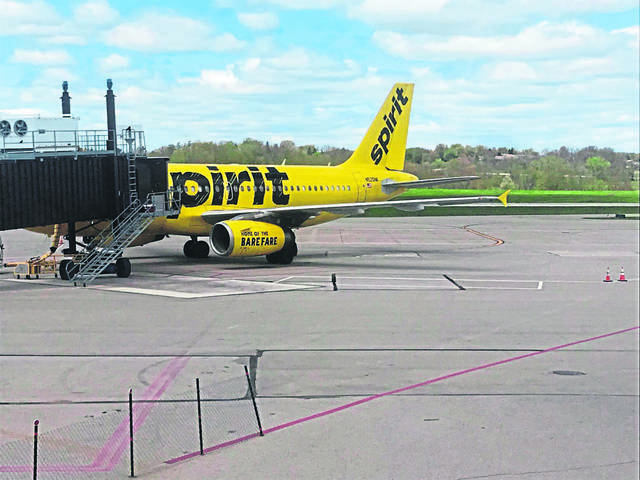 A Spirit Airlines flight to Orlando is parked at a passenger boarding bridge before takeoff on May 4, 2020, at Arnold Palmer Regional Airport in Unity.