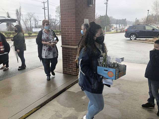 Jessica Landi, 15, of Harrison City, delivers plants to the staff at Dialysis Clinic Inc. on Route 30 in Hempfield on March 31 as part of her National Honor Society service project. She chose Dialysis Clinic in memory of her late uncle, C. Douglas Doyle, who received treatment at the clinic last year.