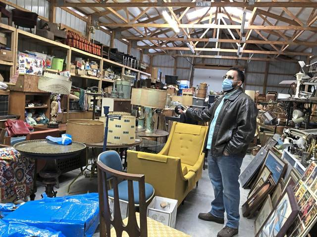 Spring Street Gallery owner Adam Dunhoff amid the collection of furnishings and accessories he has rented and sold to movie and television production companies.