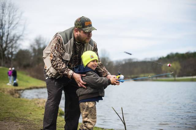 Josh Maszgay, of Vandergrift, helps his son, Luke, 5, cast his line into the lake on Saturday<ins>,</ins><ins> April 3, 2021</ins> at Northmoreland Park while fishing on opening day of trout season.