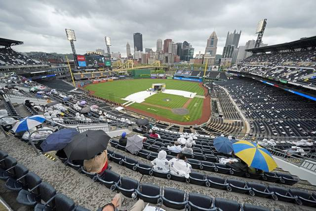 Parents and friends sit in the upper deck of PNC Park during the University of Pittsburgh graduation ceremony for the Kenneth P. Dietrich School of Arts and Sciences and the School of General Studies on May 4 at PNC Park in Pittsburgh.