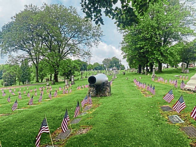 American flags have been placed on military graves at Calvary Catholic Cemetery in Hazelwood on May 24 in advance of Memorial Day on May 31.