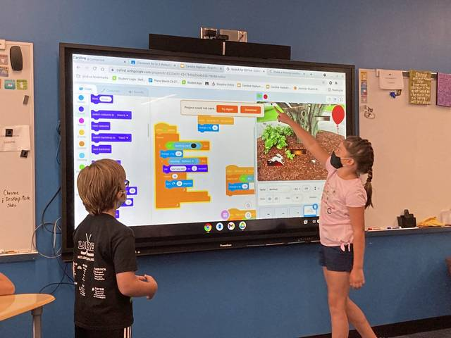 Third graders Joey Kosczuk and Caroline Hayburn work on their video game design during the June 2021 STEMtacular Makeathon camp at Latrobe Elementary School.