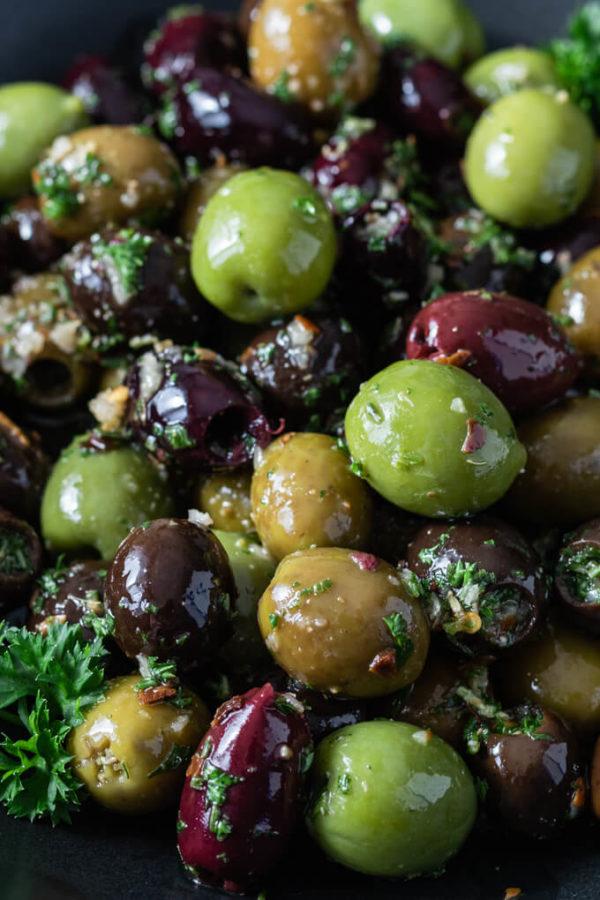 Green, black and Kalamata marinated olives with garlic and fresh herbs