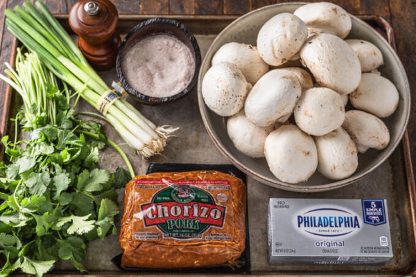 ingredients for chorizo sausage stuffed mushrooms: chorizo, cream cheese, salt, pepper, green onions, cilantro and mushrooms
